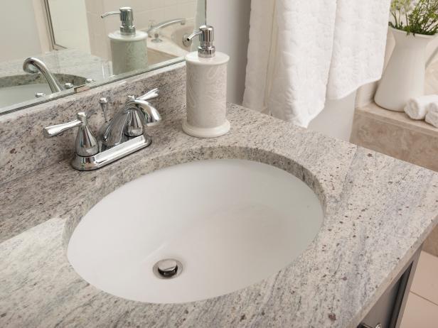 bancada de banheiro com granito