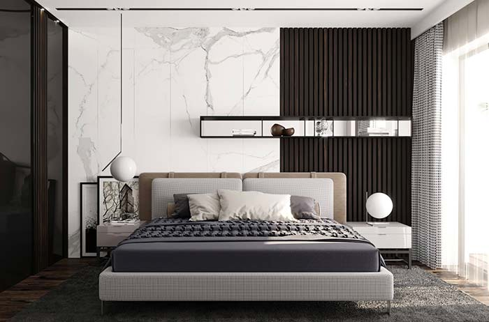 quarto com parede de mármore branco