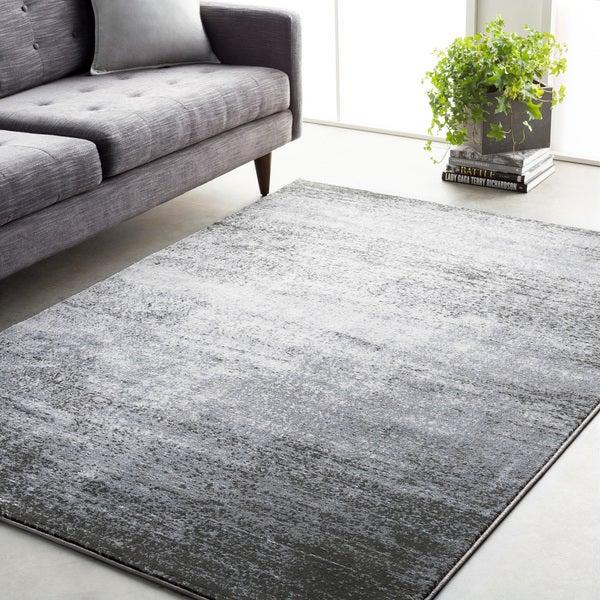 tapete retangular em frente a sofá