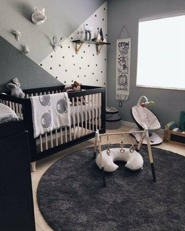 quarto de bebê decorado em tons escuros